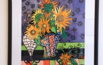 13-sunflowers-in-mosaic-vase